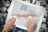 Hand touching encouragement on search bar on tablet screen — Stock Photo