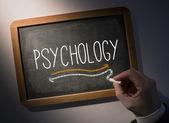Hand writing Psychology on chalkboard — Stock Photo