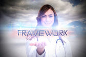 Word framework and portrait of female nurse — Stock Photo