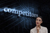 Word competitors and smiling businesswoman — Stock Photo