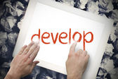 Hand touching develop on search bar on tablet screen — Stock Photo