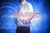 Businessman presenting the word traffic — Stock Photo