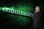 Word community and thoughtful businessman — Stock Photo