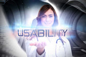 Word usability and portrait of female nurse — Stock Photo