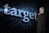 Word target and thoughtful businessman — Stock Photo