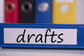 Drafts on blue business binder — Stock Photo