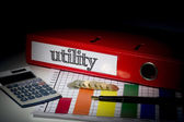 Utility on red business binder  — Stok fotoğraf