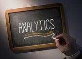 Hand writing Analytics on chalkboard — Stock Photo