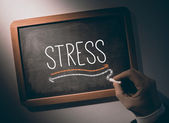 Hand writing Stress on chalkboard — Stock Photo