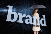 Businesswoman behind the word brand — Stock Photo