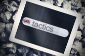 Tactics in search bar on tablet screen — Stock Photo