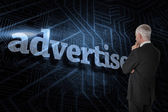 Word advertise and thoughtful businessman — Stock Photo