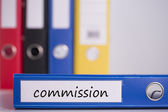 Commission on blue business binder — Stock Photo