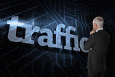 Word traffic and thoughtful businessman — Stock Photo