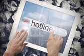 Hand touching hotline on search bar on tablet screen — Stock Photo