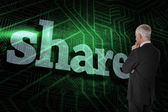 Word share and thoughtful businessman — Stock Photo
