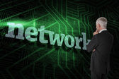 Word network and thoughtful businessman — Stock Photo