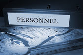 Personnel on blue business binder  — Stock Photo