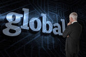 Word global and thoughtful businessman — Stock Photo