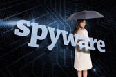 Businesswoman behind the word spyware — Stock Photo
