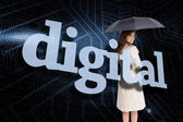 Businesswoman behind the word digital — Stock Photo