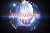 Businessman presenting the word - malware — Stock Photo