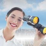 Business woman with binoculars — Stock Photo #44884475