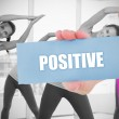 Fit blonde holding card saying positive — Stock Photo #44886429