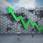Business team holding up arrow — Stock Photo