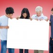 Casual group showing card — Stock Photo