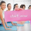 Woman holding pink card saying start now — Stock Photo #44889089