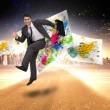 Smiling businessman in a hurry — Stock Photo #44889807
