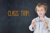 Class trip! against schoolboy and blackboard — Stock Photo