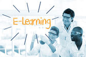 E-learning against scientists working in laboratory — Stock Photo