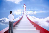 Professional against red steps arrow pointing up against sky — Stock Photo