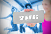 Fit blonde holding card saying spinning — Stock Photo