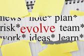 Evolve against sticky notes strewn over notepad — Φωτογραφία Αρχείου