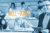 Well-done! against lecturer standing in front of his class in lecture hall — Stock Photo