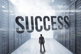 Success against server hallway in the blue sky — Stock Photo