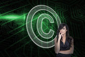 Copyright symbol and sexy brunette — Stock Photo
