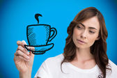 Businesswoman drawing coffee cup — Stock Photo