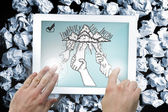 Composite image of hands touching tablet — Stock Photo