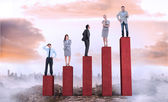 Business people on bar chart — Stock Photo