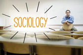 Sociology against lecturer sitting in lecture hall — Stock Photo