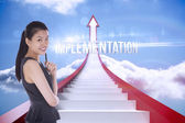 Implementation against red steps arrow pointing up against sky — Stock Photo