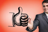 Businessman drawing thumbs up — Stock Photo