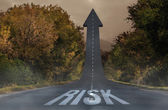 Risk against road turning into arrow — Stock Photo