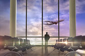 Businessman against airplane flying — Стоковое фото