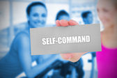 Fit blonde holding card saying self command — Stock Photo