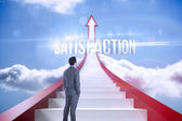 Satisfaction against red steps arrow pointing up against sky — Stock Photo